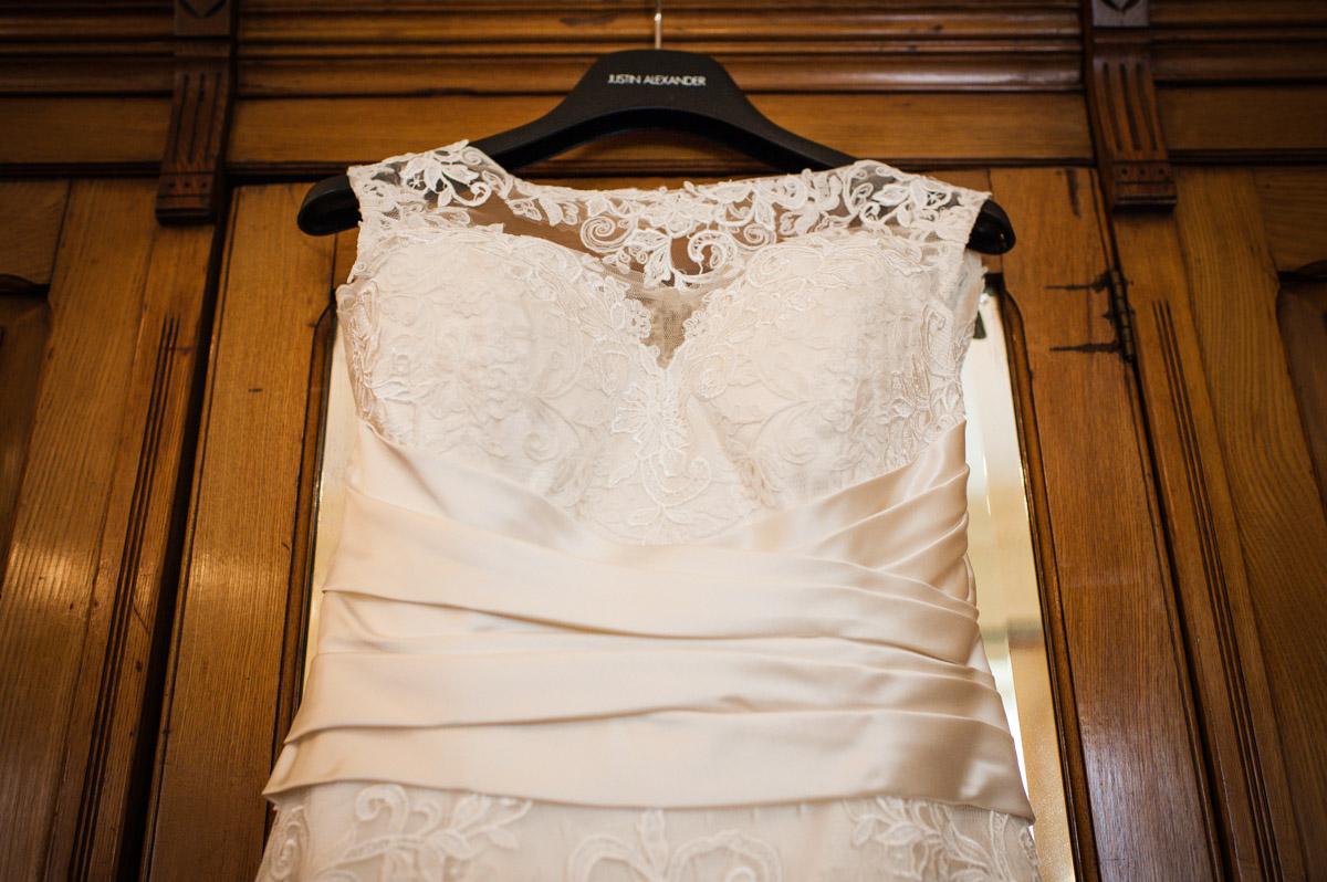 Photograph of wedding dress hanging on the wardrobe at Bradbourne House