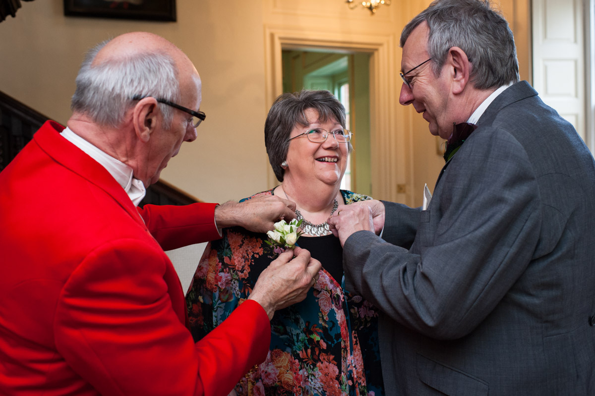 Toast master helps put on button holes at Bradbourne House wedding