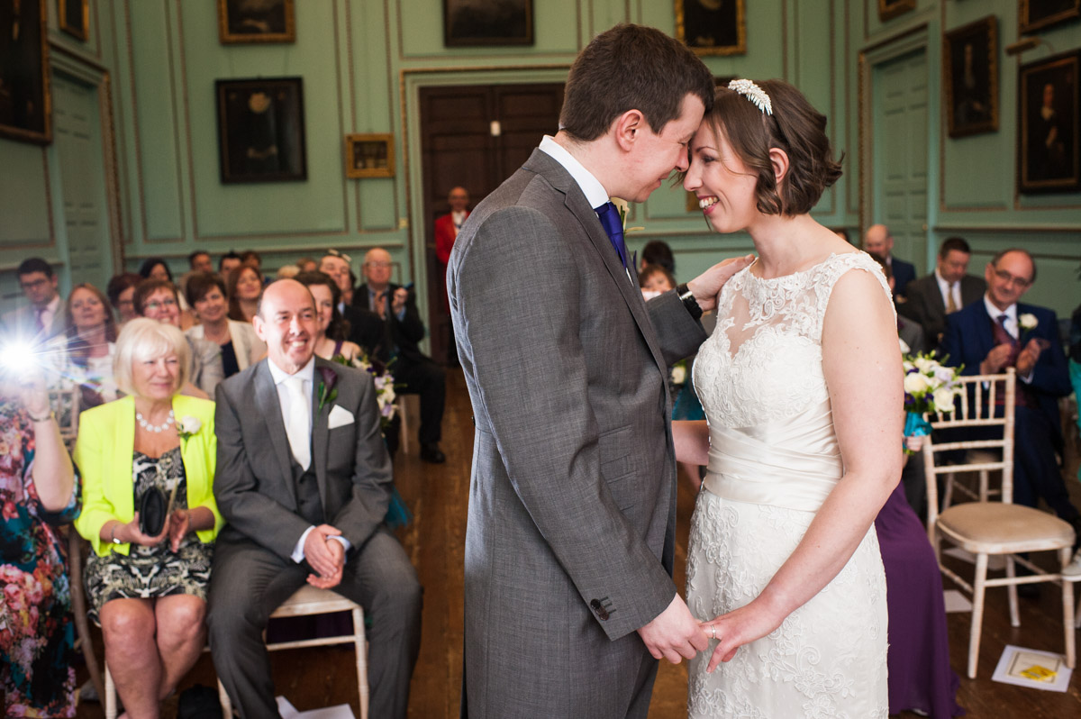 The bride and groom gaze into each other's eyes at the end of their marriage ceremony at Bradbourne House