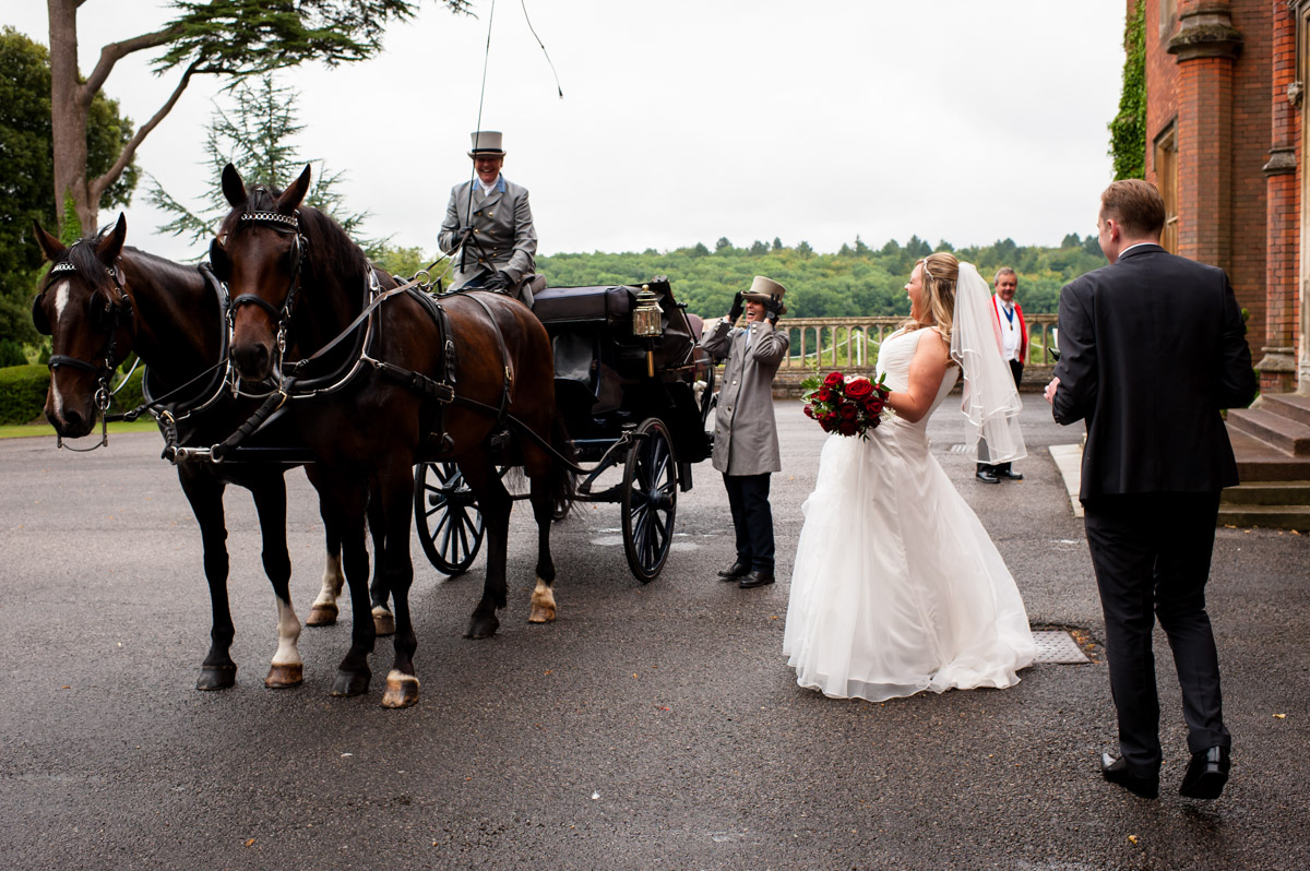 Bride and horse drawn carriage outside Latimer Place