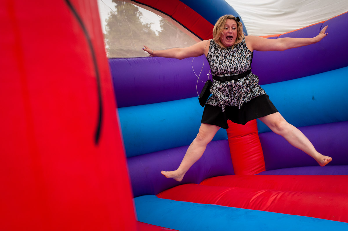 Guest enjoys use of bouncy castle at Latimer Place wedding
