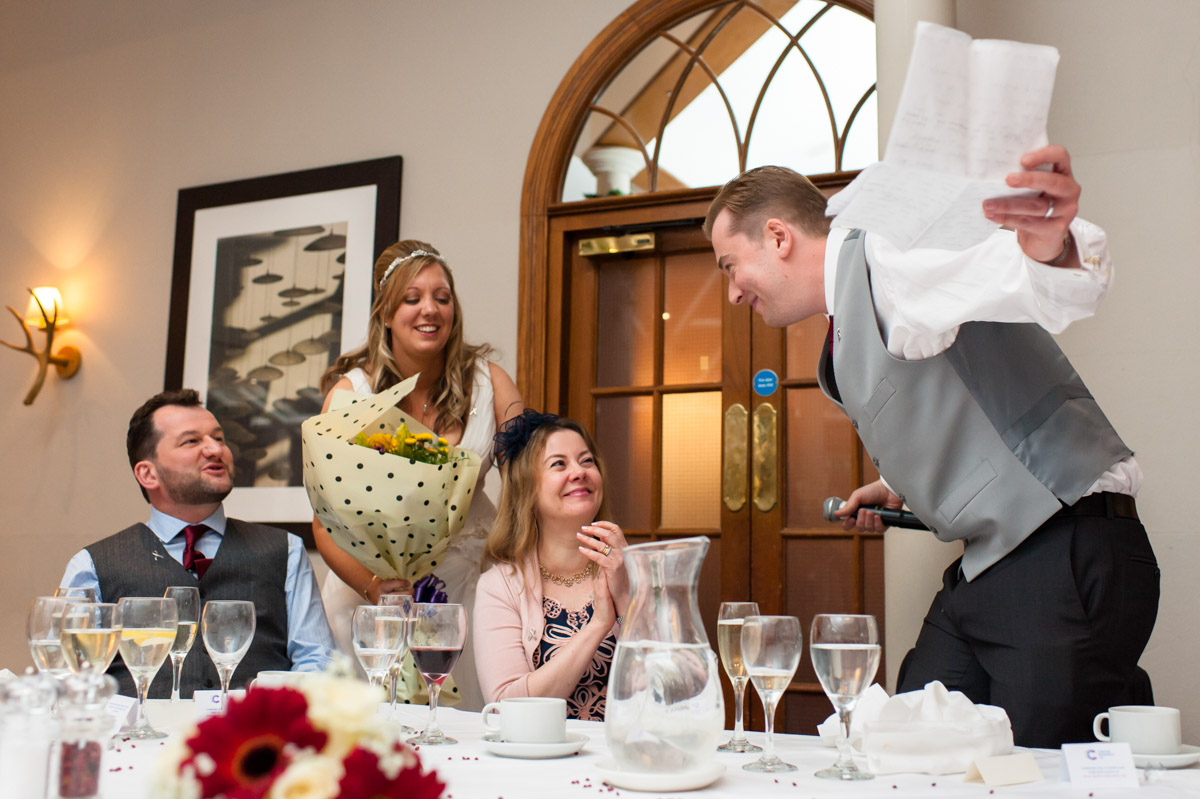 Groom takes a bow after his speech during wedding reception at chatter Place