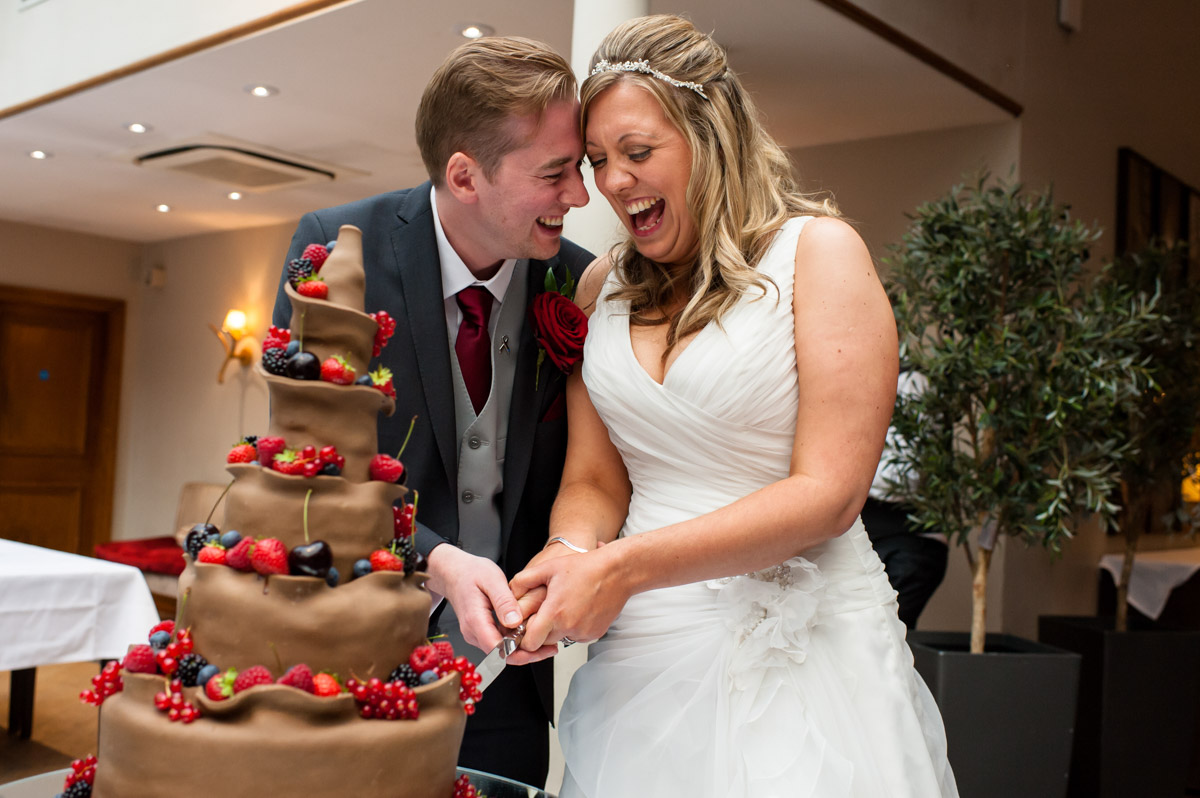 Photo of wedding cake cutting at Latimer Place wedding