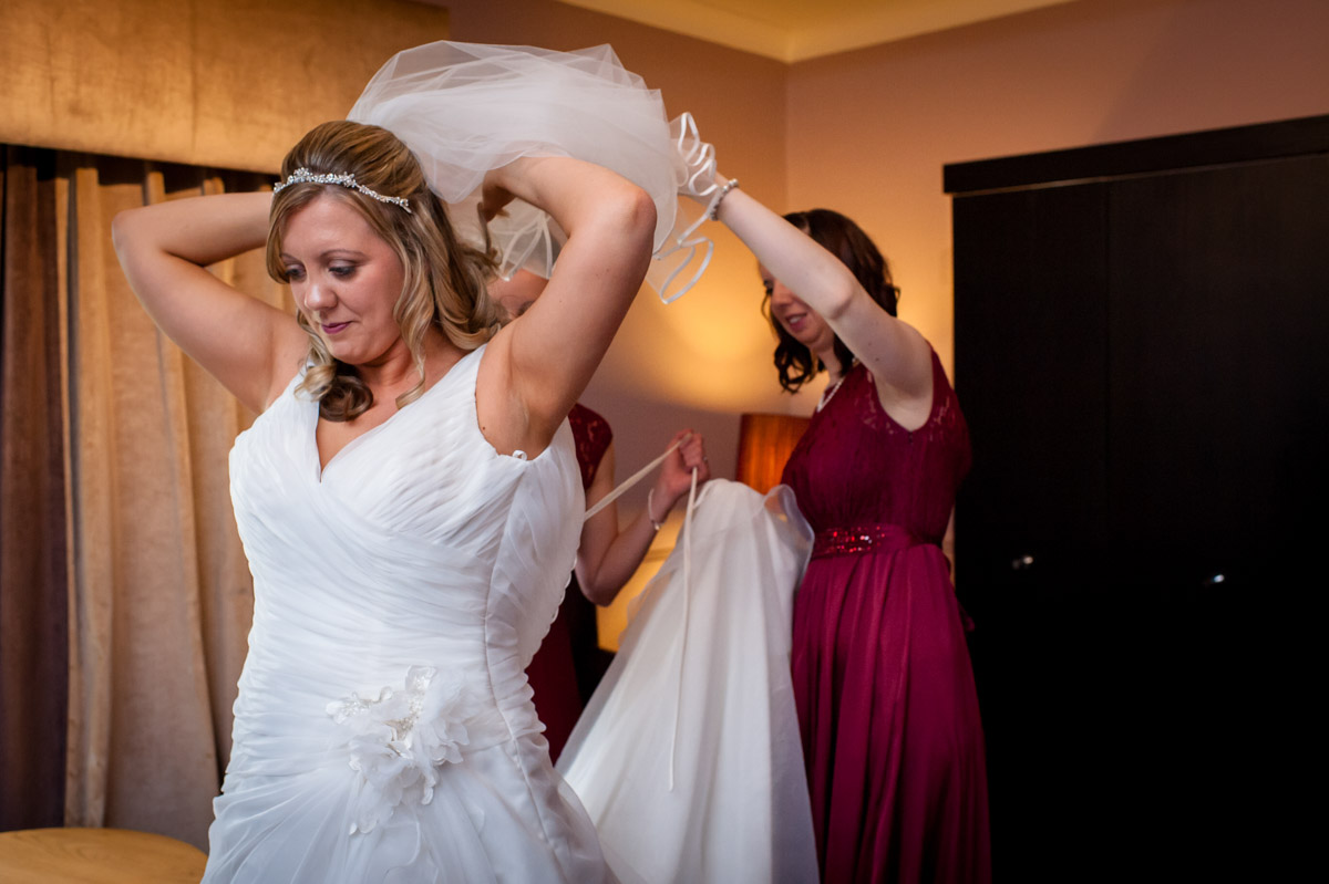 Bride and bridesmaids photographed while getting ready at Latimer Place