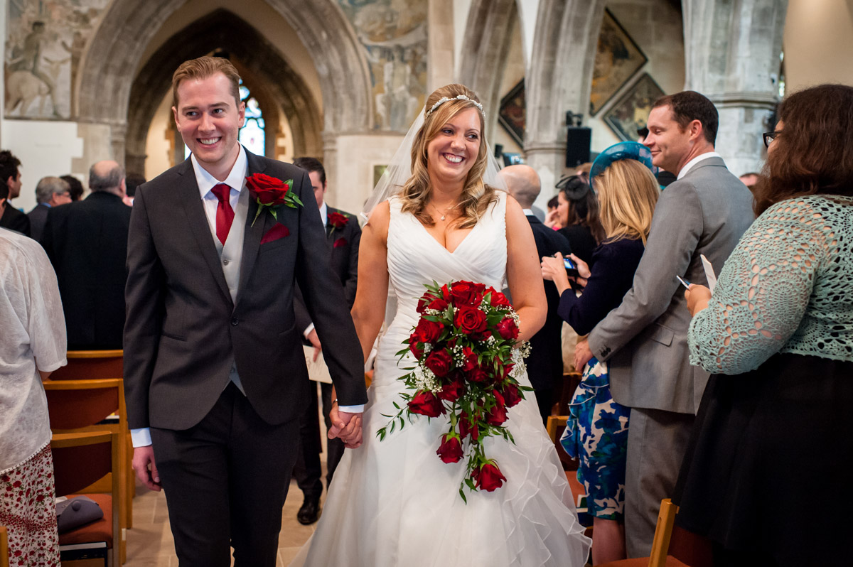 Bride and Groom walk down the aisle after wedding at St Mary's Church Chesham