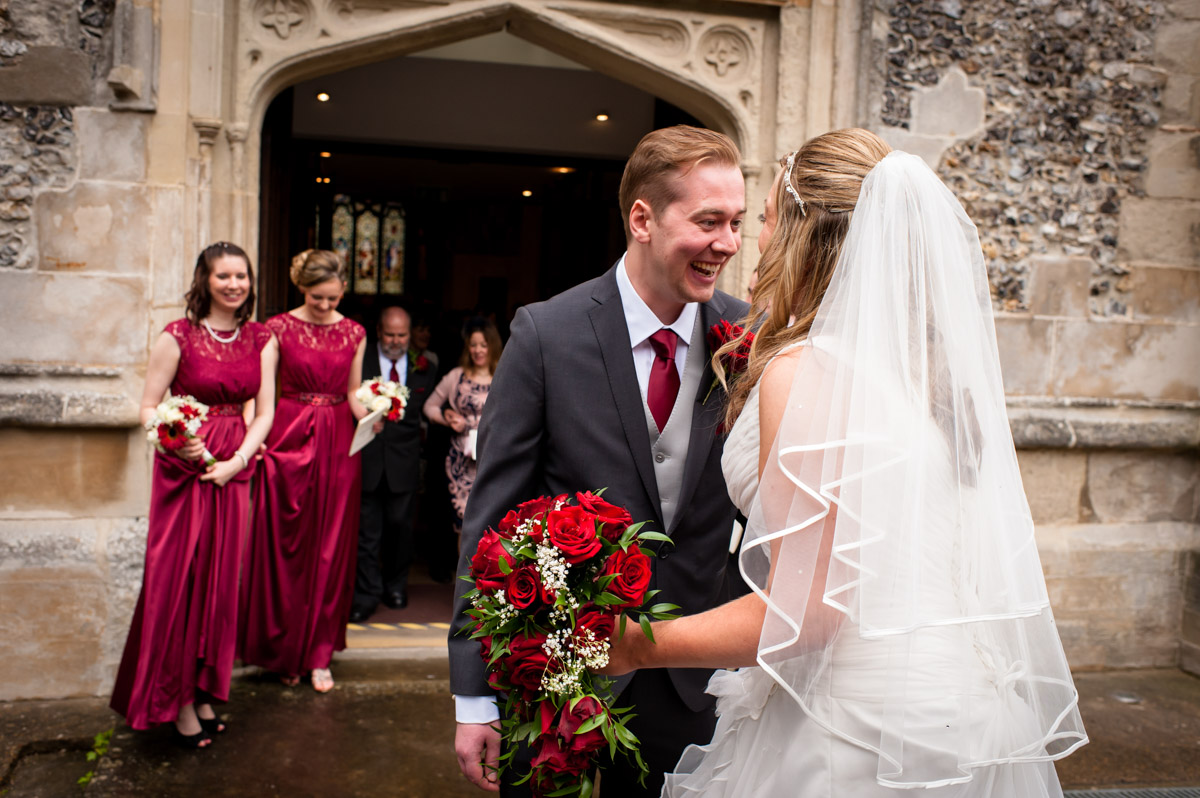 Photograph of bride and groom outside St Mary's Church, Chesham