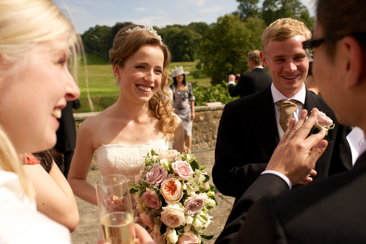 timea and edmund enjoy time outside on the grounds after their wedding ceremony at leeds castle