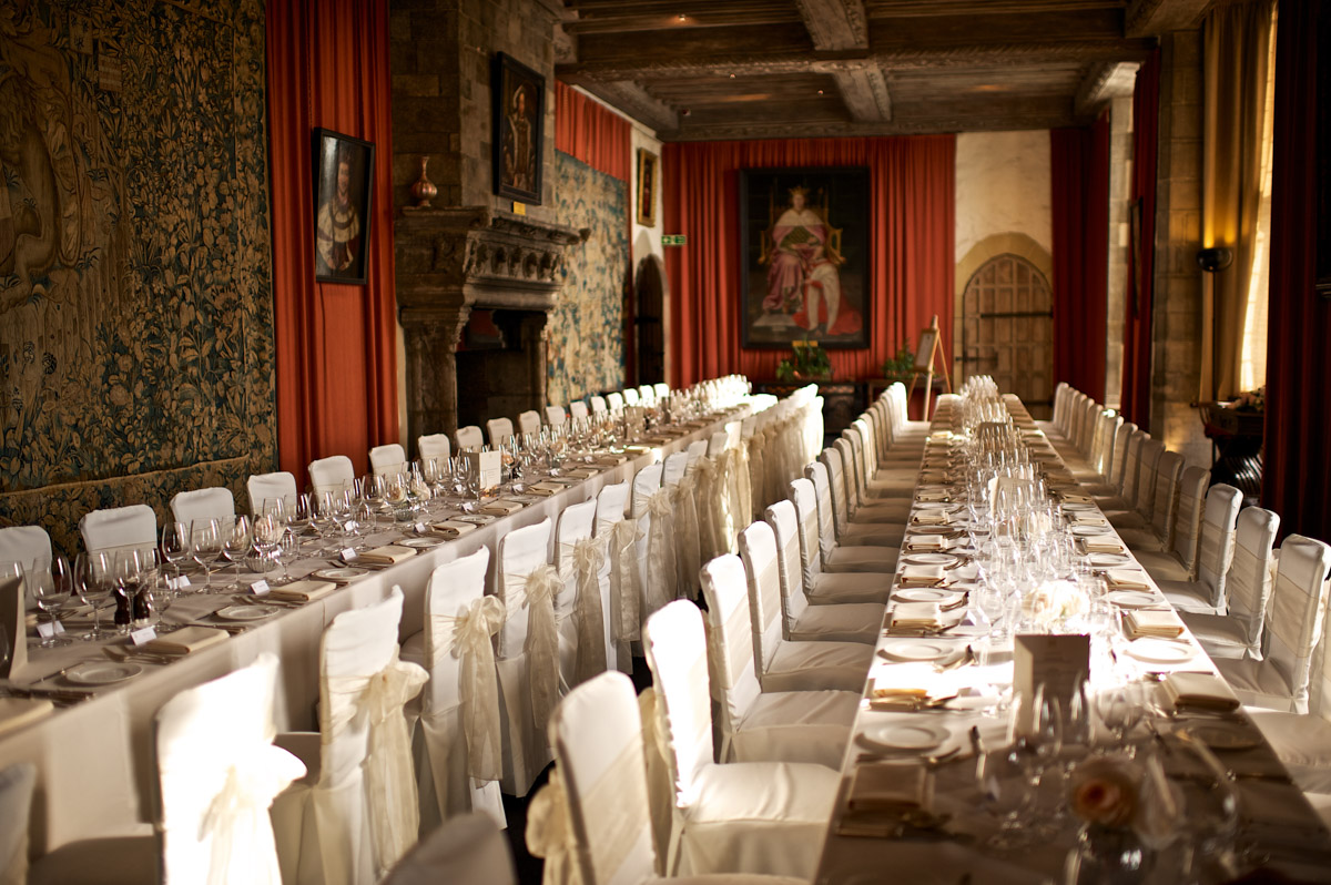 photograph of long tables laid for time and edmunds wedding reception meal