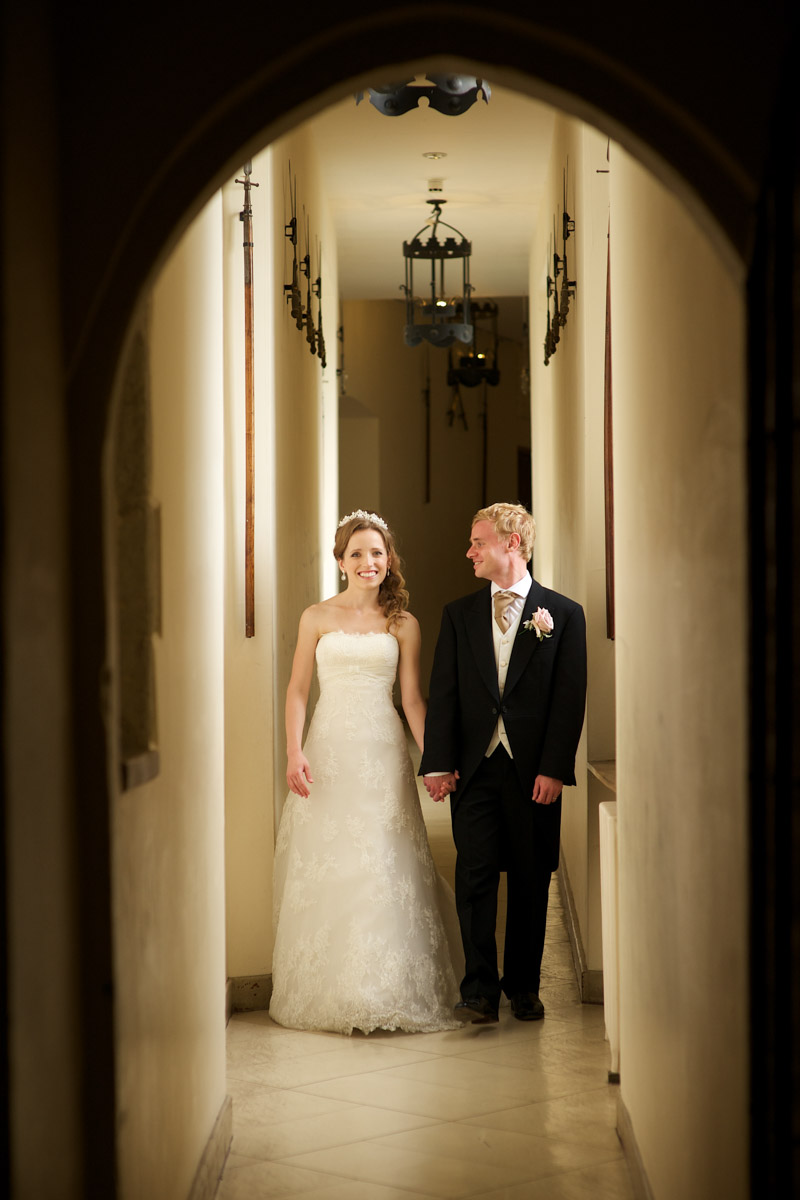 timea and edmund are photographed in leeds castle on their wedding day