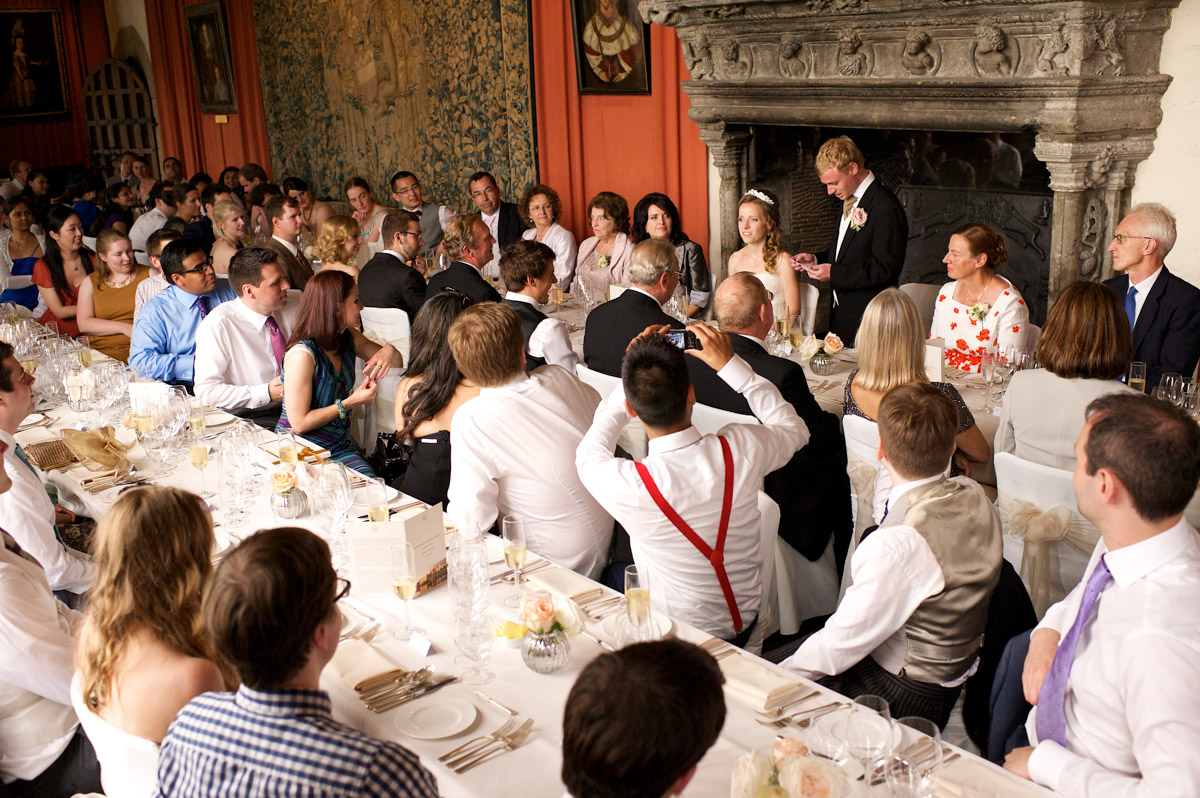 photograph of guests listening to edmund doing his wedding speech at leeds castle in kent