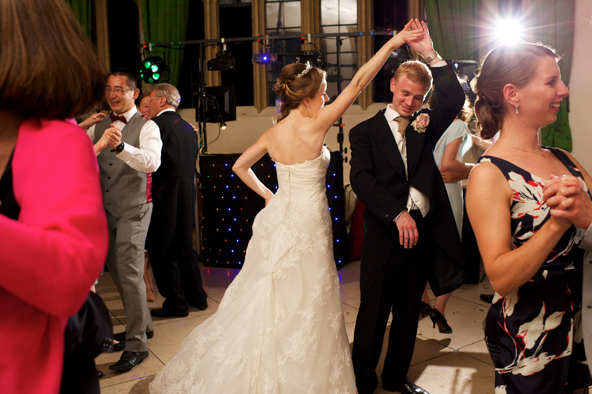 guests join timea and edmund on the dance floor at their wedding at leeds castle