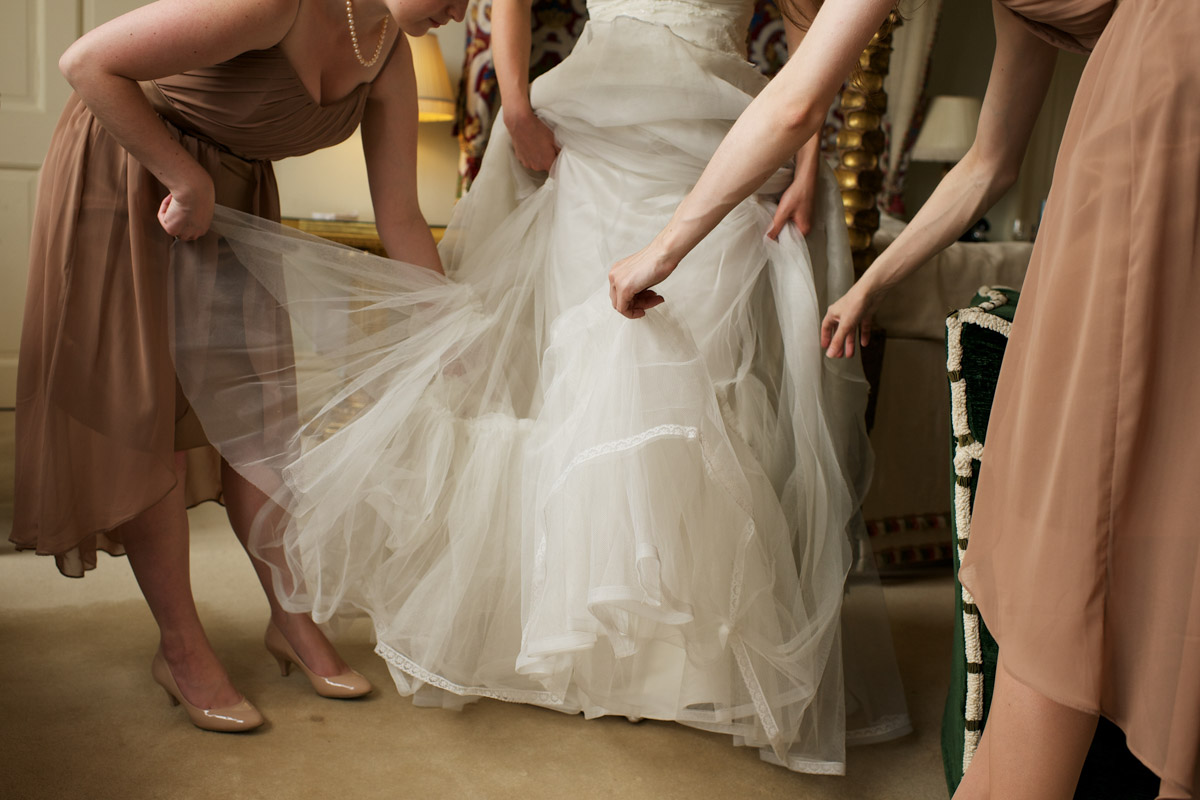 Timeas bridesmaids adjust her wedding dress before her ceremony at leeds castle in kent