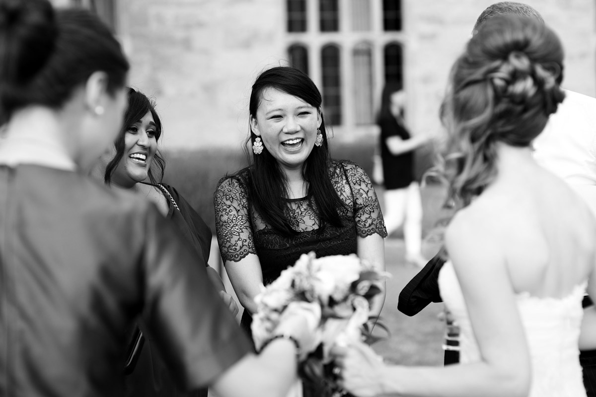 wedding guests talk to timea outside leeds castle on her wedding day