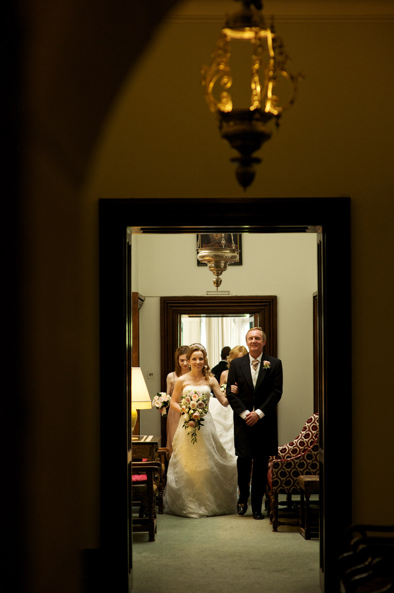 timea and her dad walk down the corridor on her way to her leeds castle wedding ceremony