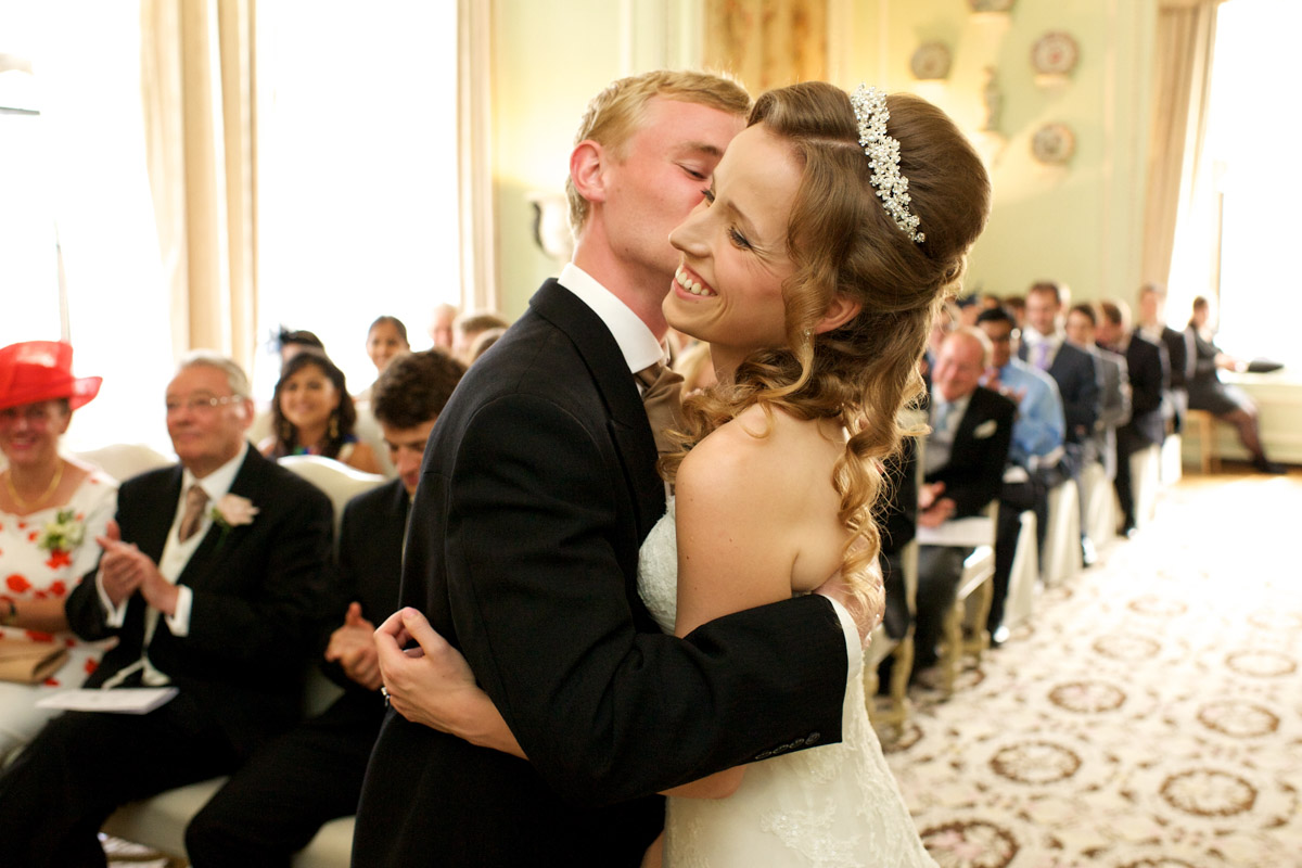 photograph of timea and edmund kissing during their leeds castle wedding ceremony