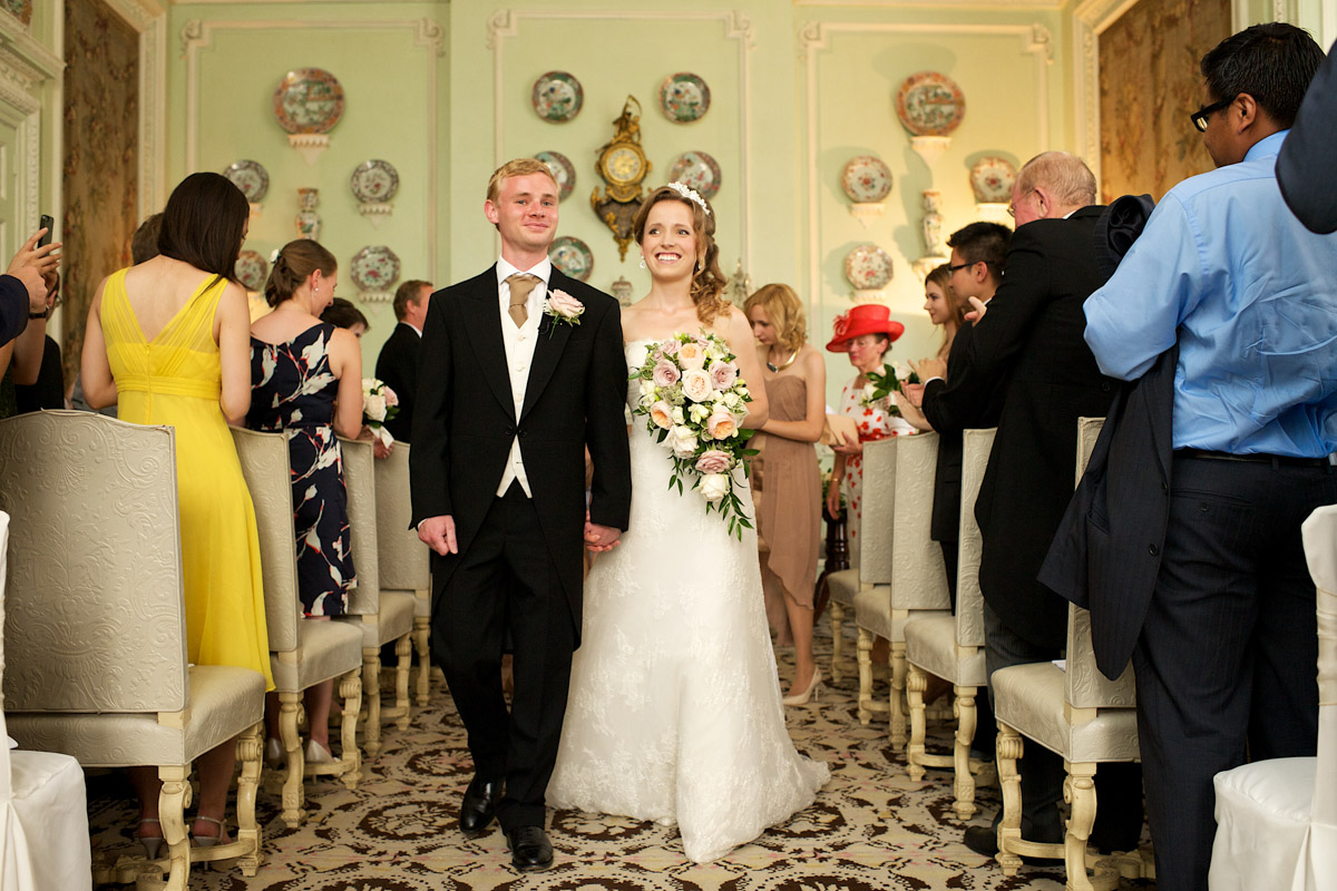 timea and edmund walk down the aisle after their wedding ceremony at leeds castle in kent