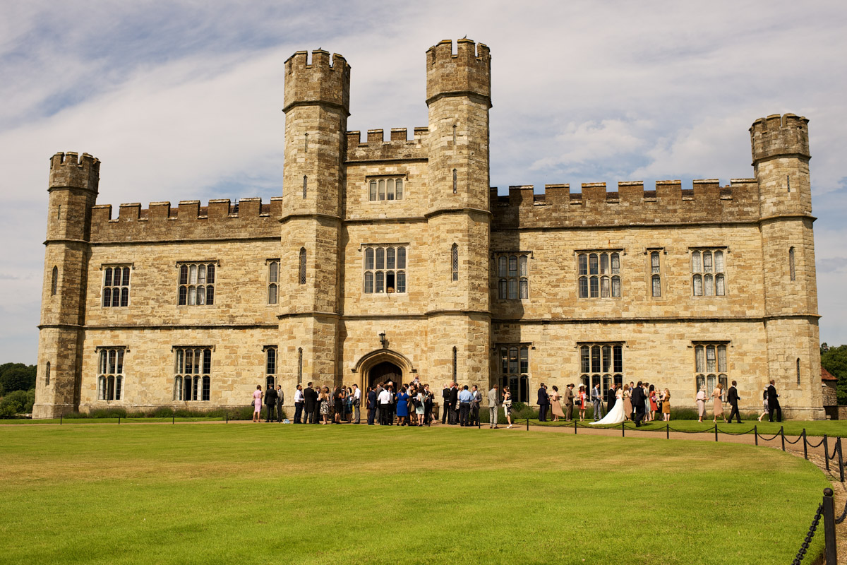 photograph of leeds castle with wedding guests outside