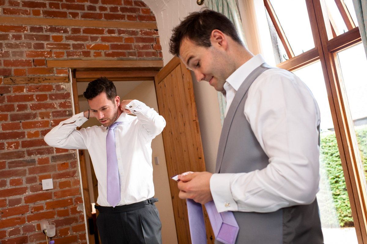 Groom getting ready for wedding at Winters Barn