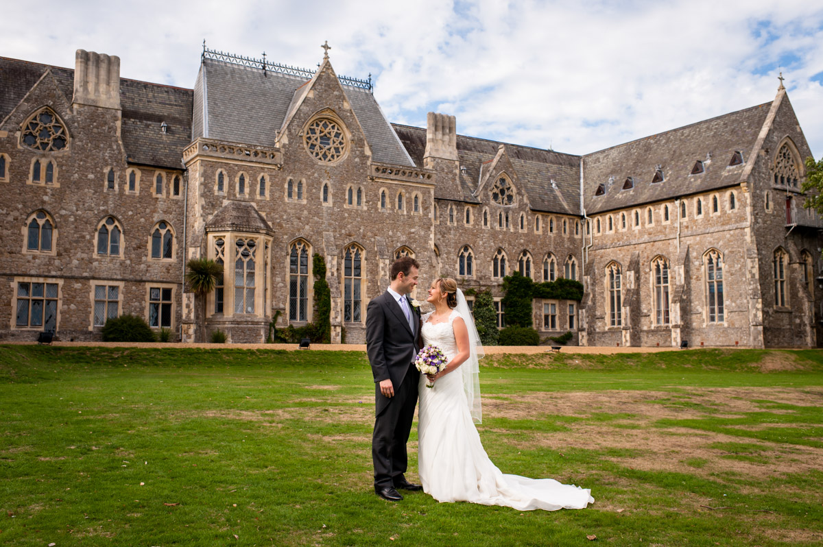 Photo of bride and groom outside St Edmunds School Chapel, Canterbury, on their wedding day