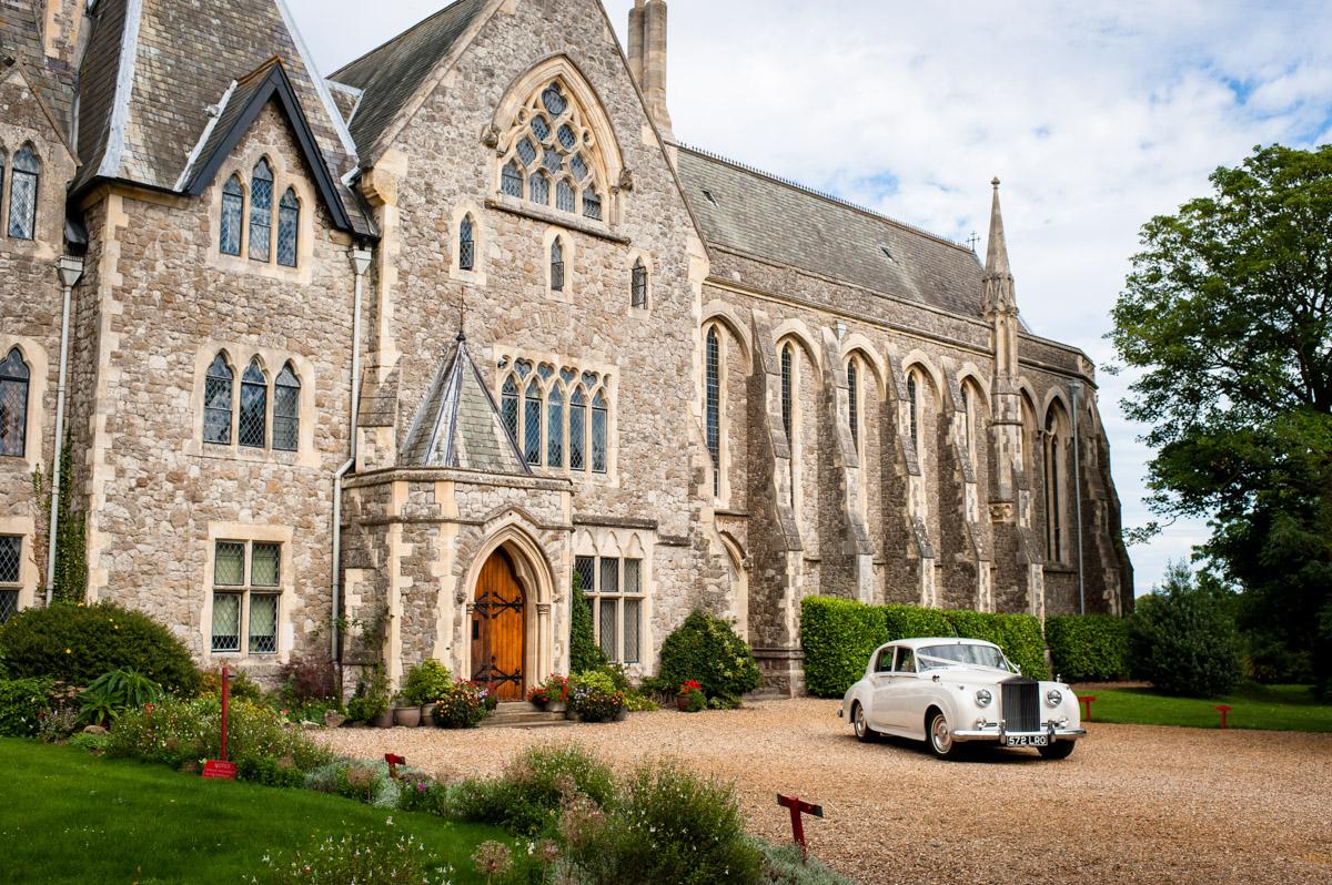 Rolls Royce wedding car leaving St Edmunds Chapel, Canterbury