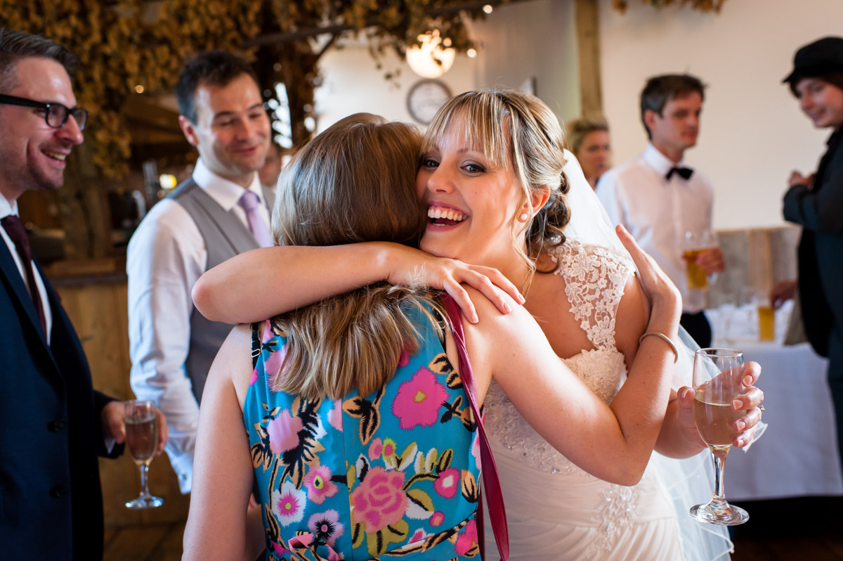 Bride is congratulated by friends at Winters Barn, Canterbury, on her wedding day