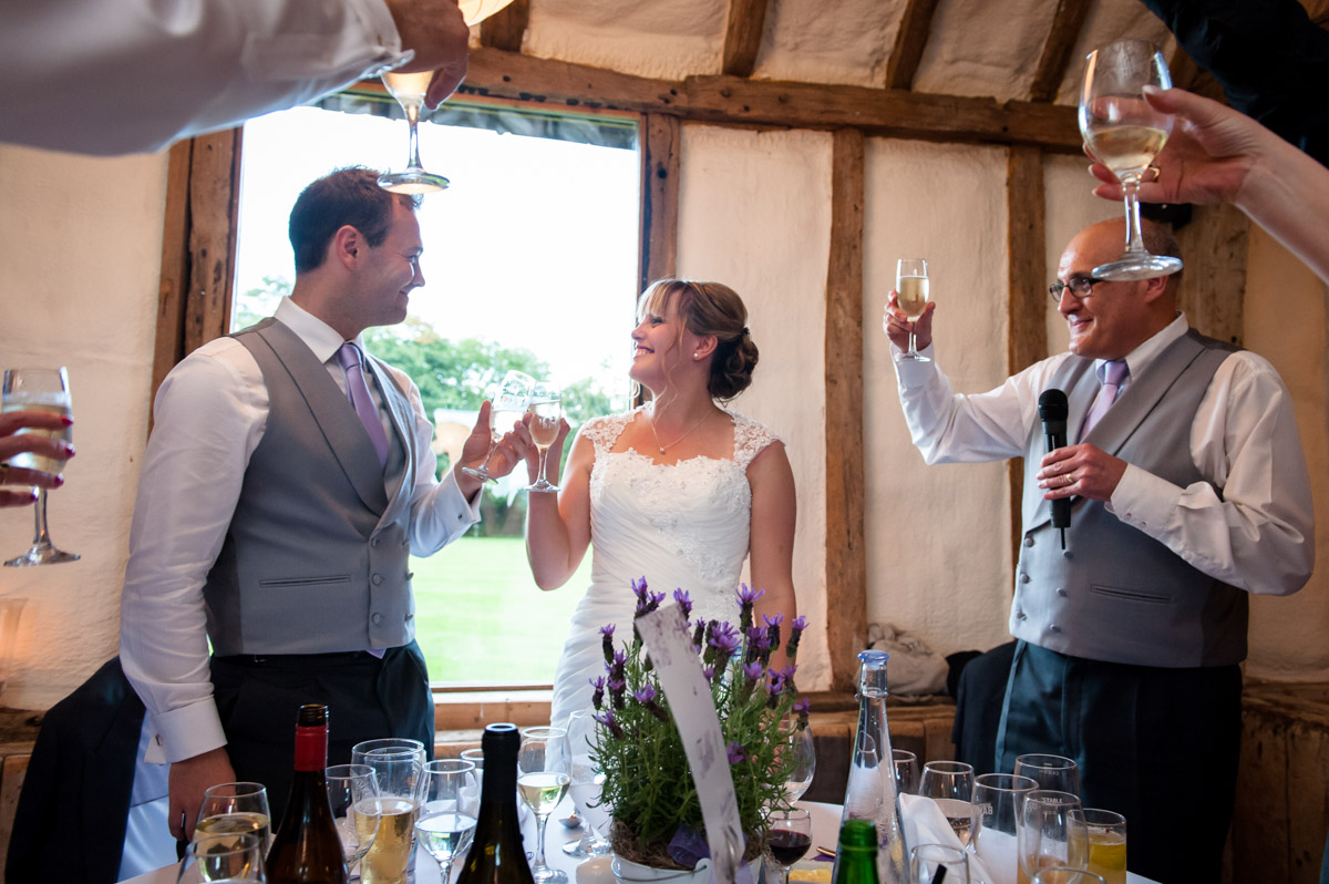 Toasting the wedding couple during reception speeches at Winters Barn, Canterbury