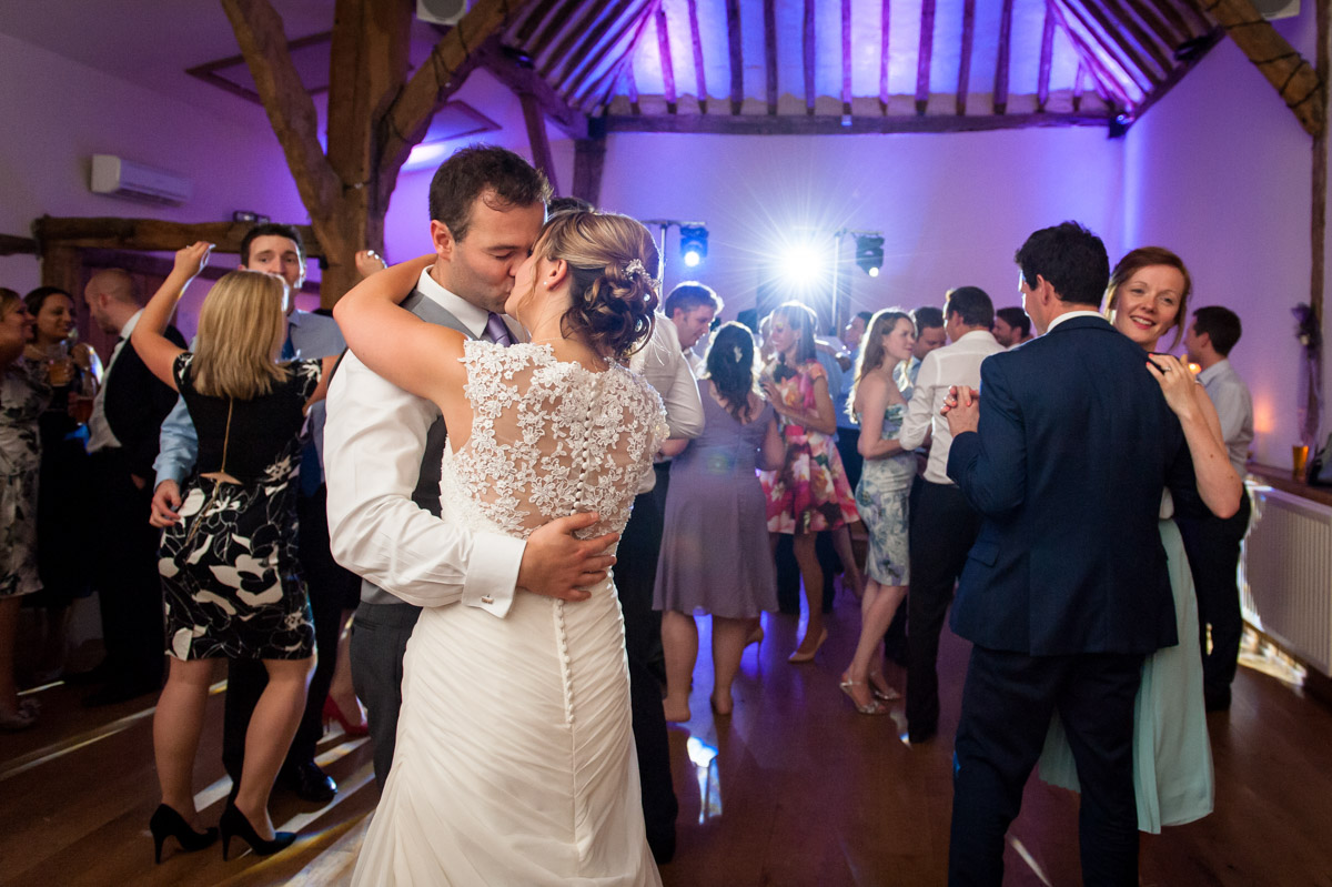 Wedding couple and guests dancing during reception at Winters Barn reception