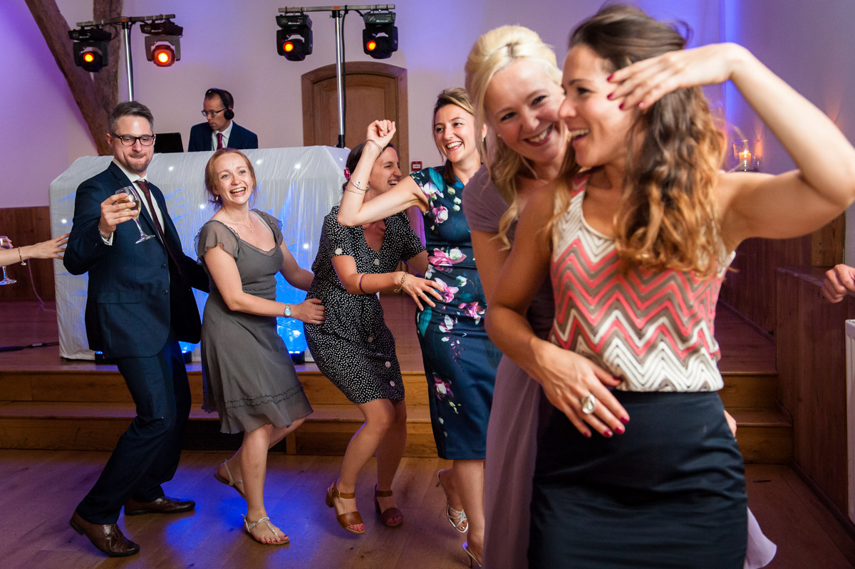Guests do the conga at Winters Barn wedding