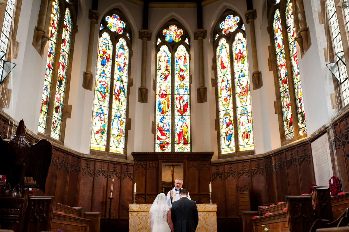 Bride and Groom at the alter in St Edmunds Chapel, Canterbury on their wedding day