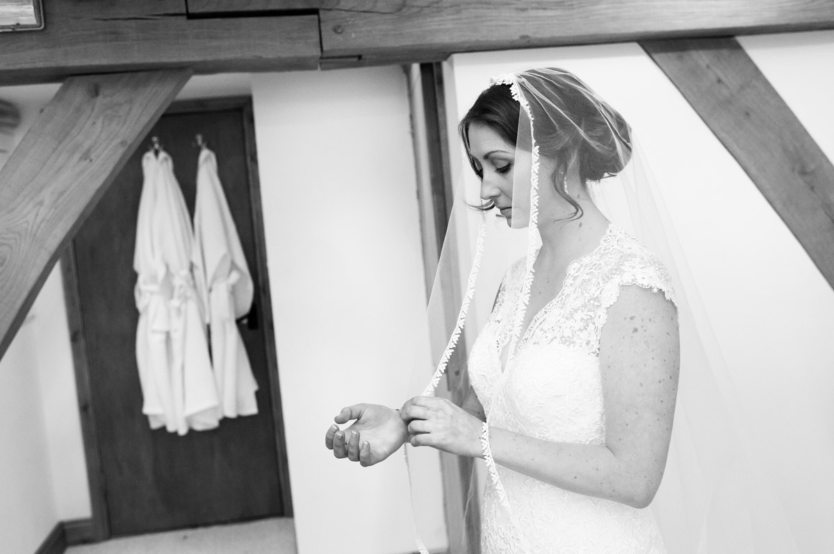Bronwyn in her wedding dress before ceremony at the old kent barn