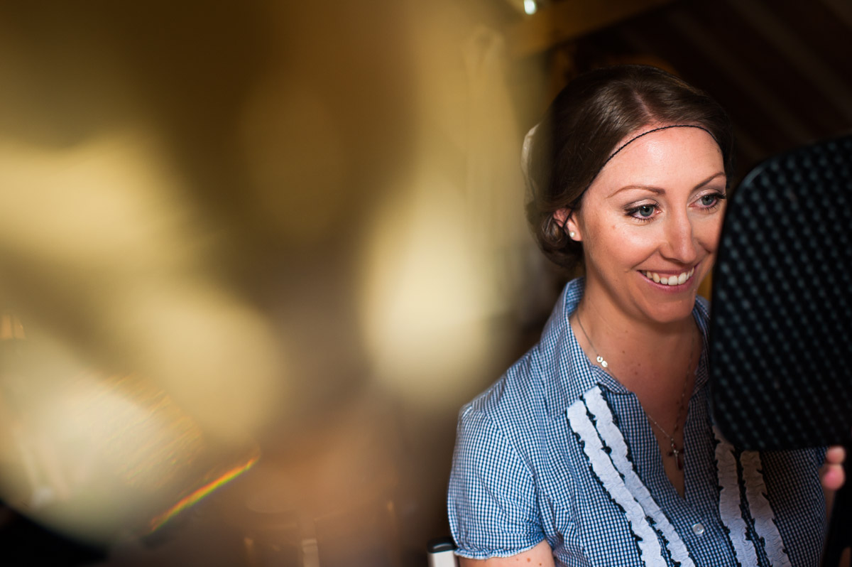 Bronwyn is photographed getting ready for wedding at The Old Kent barn