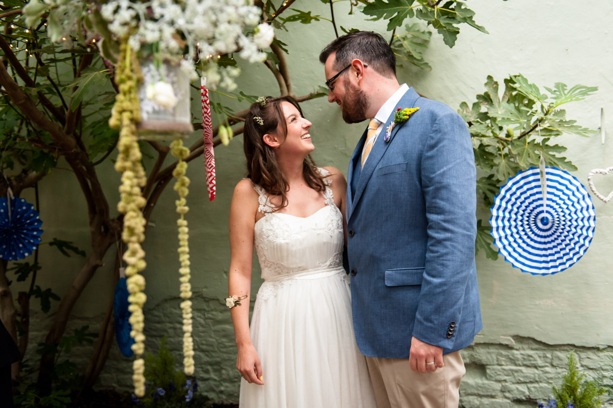Rachel and daniel photographed during their glass house wedding at the secret garden in kent