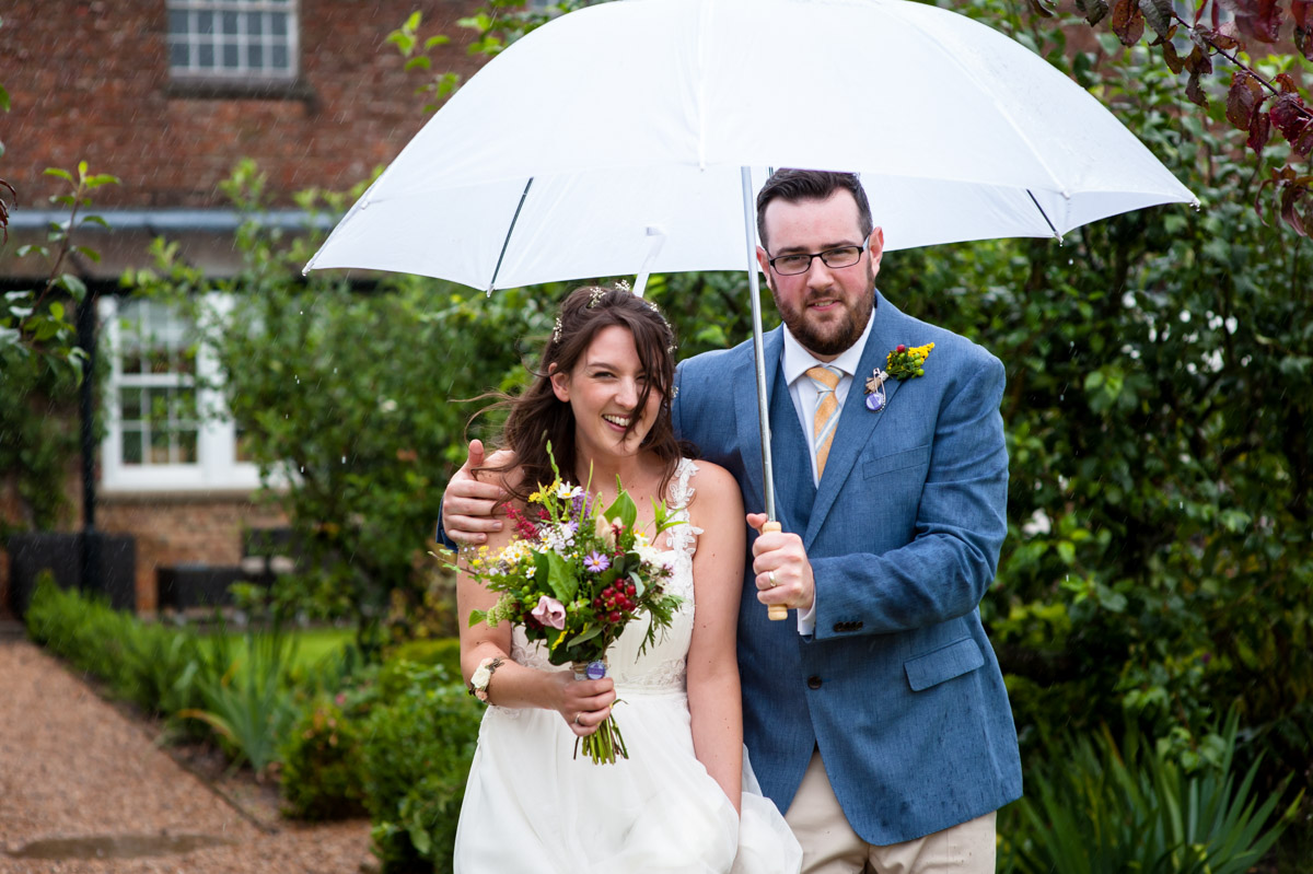 Rainy day wedding at the secret garden in kent