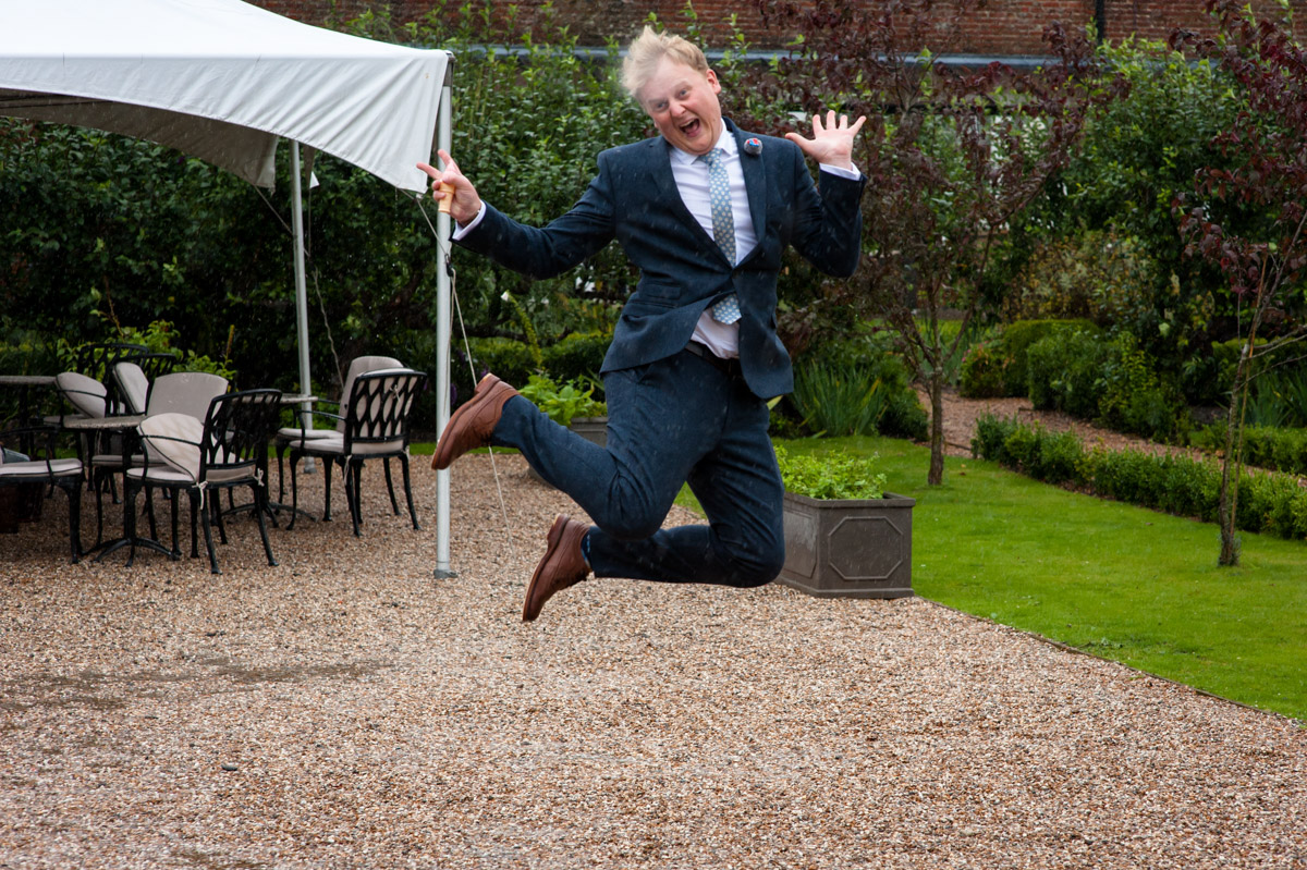 wedding guest having fun at secret garden wedding