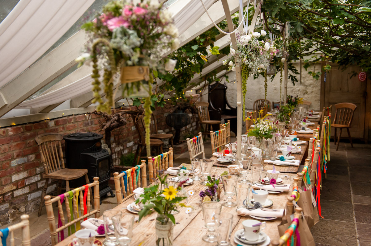 Inside the glass house at the secret garden, wedding table decorations