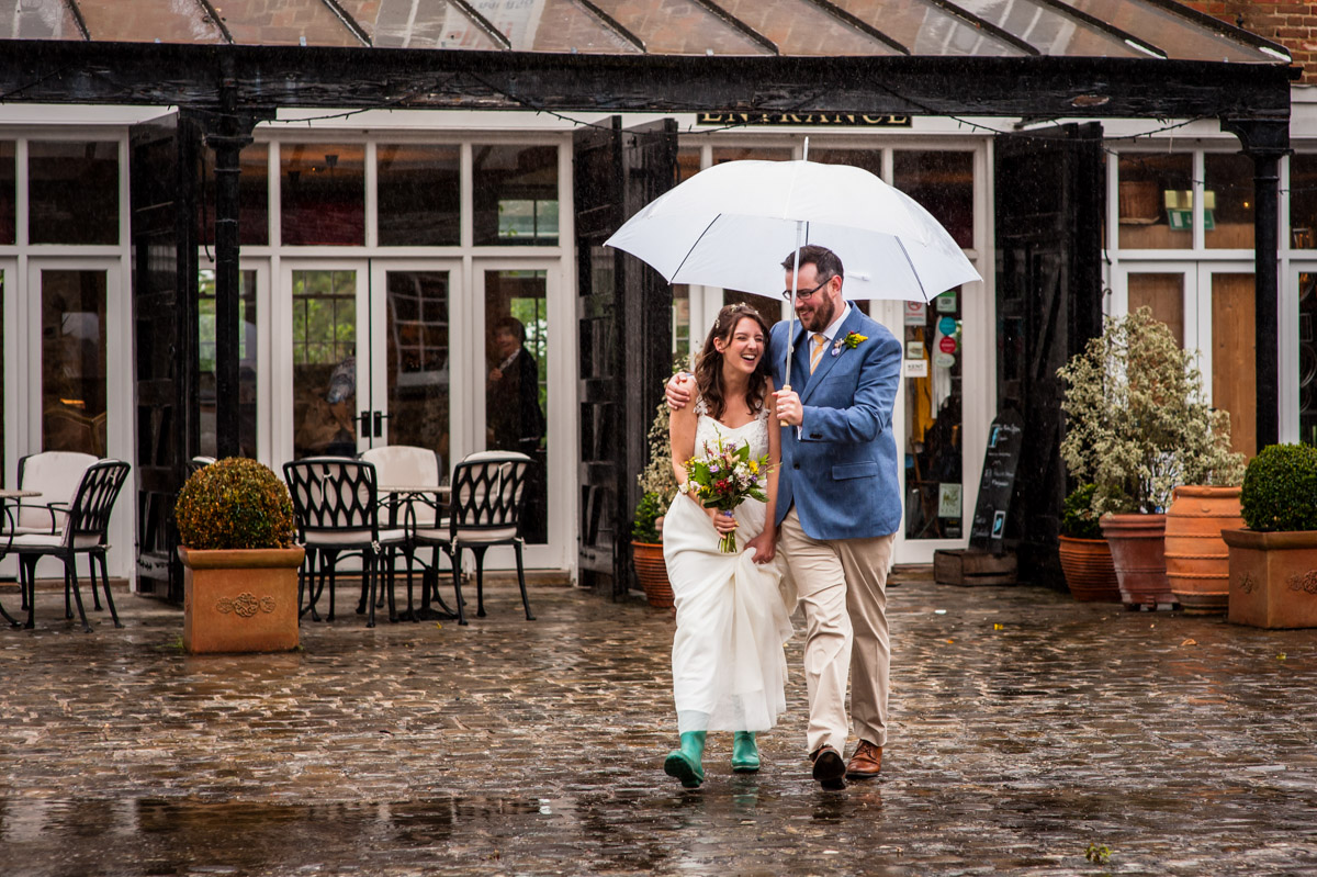 rainy wedding couple photograph in the secret garden courtyard
