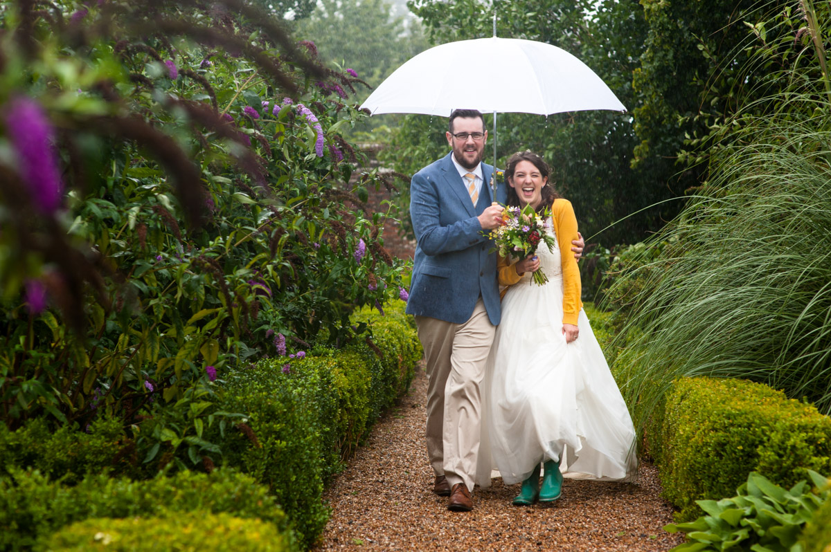 The secret Garden rainy wedding day photograph of Rachel and Daniel