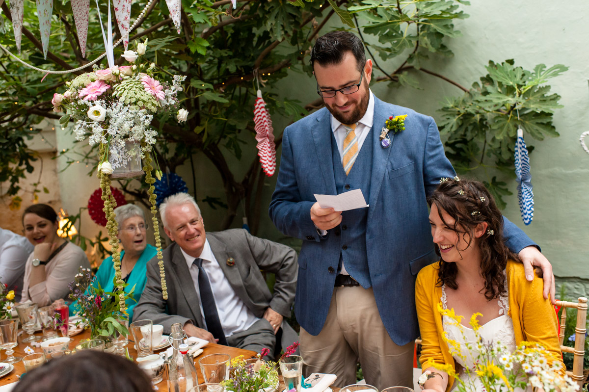 daniel makes his wedding speech in the glass house at the secret garden in kent
