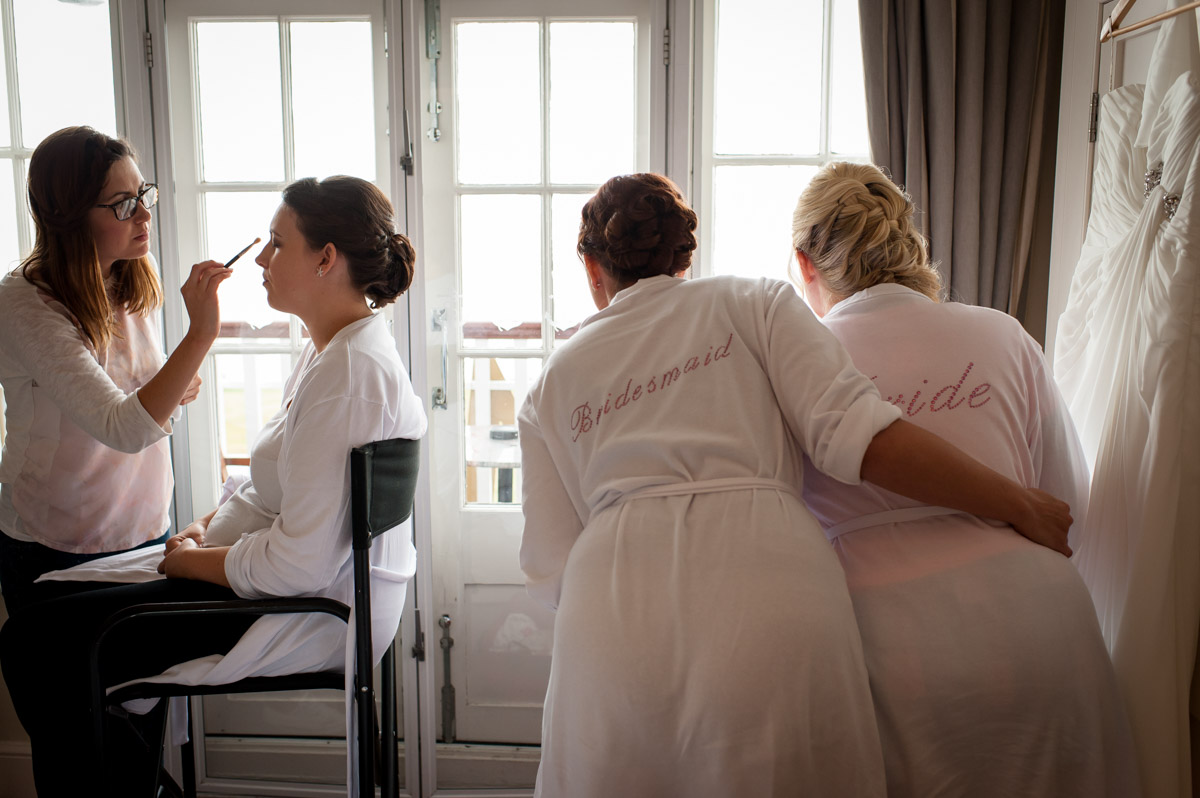 Bride and bridesmaids getting ready for Laurens wedding at Whitstable Castle on Kent coast