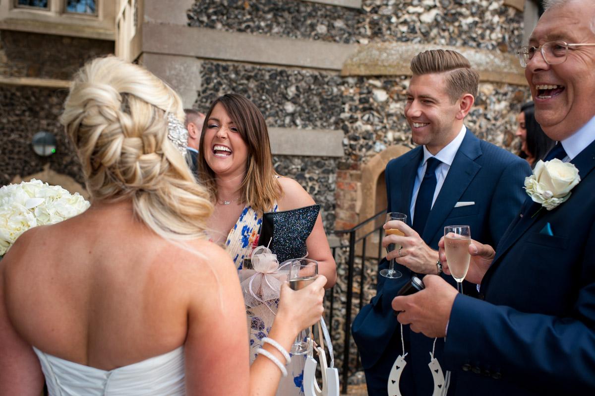 Lauren talks to wedding guests in whitstable castle grounds