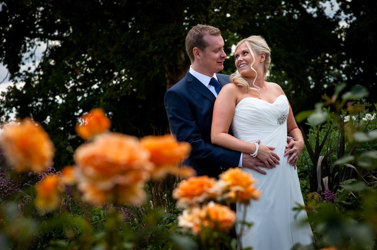Photograph of Jay and Lauren in Whitstable gardens on their wedding day