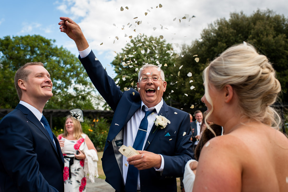 Laurens dad throws confetti their kent wedding ceremony at whitstable castle