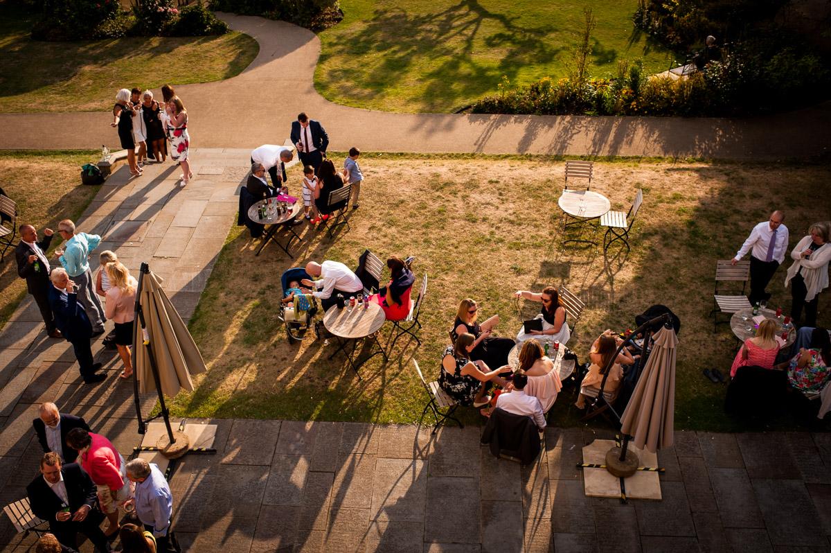 Birds eye view of wedding guests in Whitstable castle garden in Kent