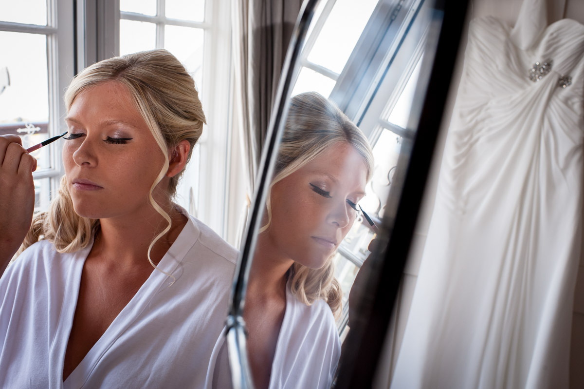 Lauren is photographed having her make up done before the wedding at Whitstable Castle