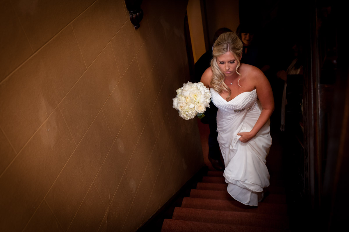 Lauren walks up steps at Whitstable castle before her wedding ceremony