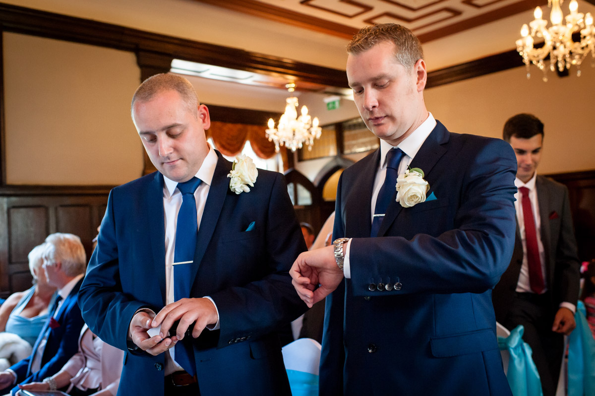 Groom photographed checking his watch before the wedding ceremony at Whitstable Castle