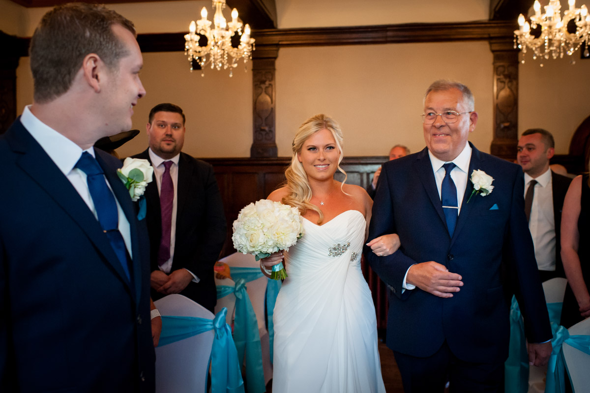 Father escorts Lauren down the aisle during wedding at Whitstable Castle