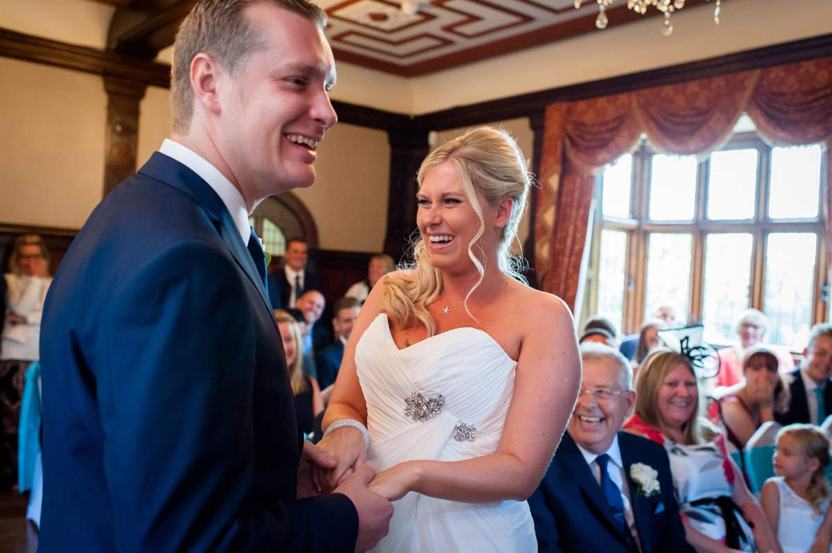 Lauren and Jay laughing during their wedding ceremony at Whitstable castle