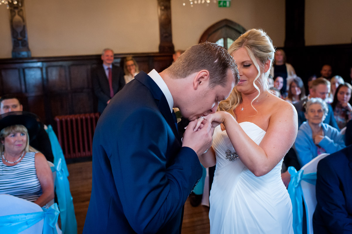 Photograph of Jay kissing Laurens hand after their wedding ceremony at Whitstable Castle