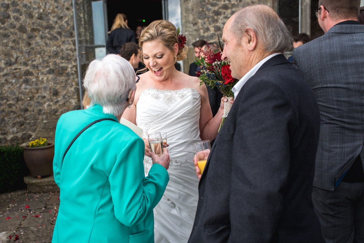 Lianne laughs with her gran after her wedding ceremony at Lympne Castle in kent